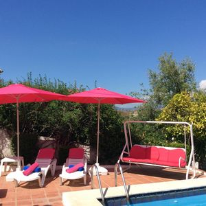 Photo for Pretty 3 Bed villa with heated pool . Great location