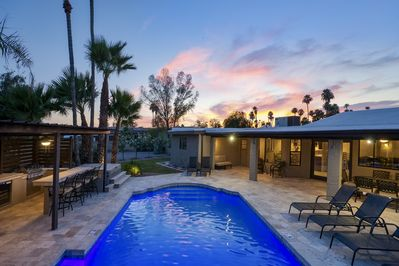 A beautiful view of the back yard. You have the in ground pool nestled between two verandas, one with plenty of seating for outdoor dining, the other equipped with a grill and bar. A perfect space to enjoy the Arizona weather!