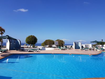 Photo for Beautiful apartment on the foot of the pool, with sea views, free Wi-Fi