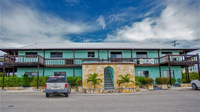 Photo for Centrally located, comes with gazebo, world famous Grace Bay beach, cooler & CAR