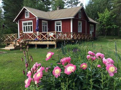 Photo for Cozy traditional cottage for 2 on the sea shore! Sauna|hot tub|fishing pier|boat