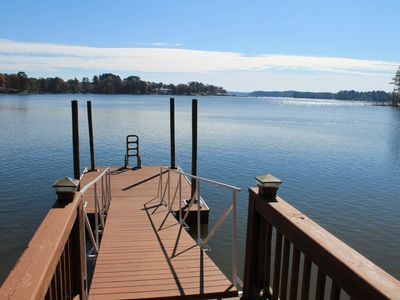 Photo for NEW LISTING! Lakefront & dog-friendly home w/ dock, paddle boat, and lake views!