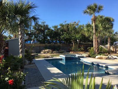 Your own tropical paradise, with heated pool, spa, palm trees and cool zone.