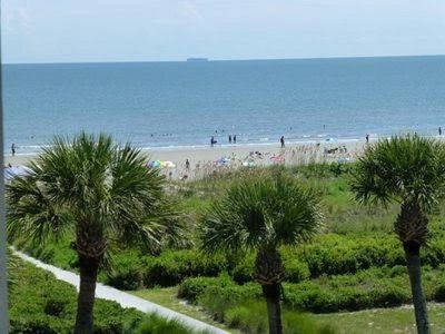 Photo for Unit 329 - Beautiful top Floor Unit! Ocean View From our Balcony. Free Gym!