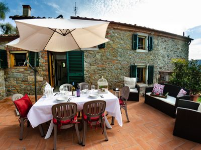 Photo for Apartment in villa with pool, A/C, internet, TV, terrace, panoramic view, parking, close to Lucca
