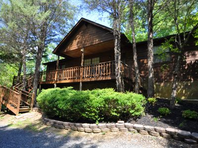 "Photo for ""Smokies Hideout"" is a custom-built cabin nestled in the woods just minutes from Dollywood."