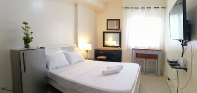 Photo for A cozy studio unit, fully furnished. The room can accommodate maximum of 4guests