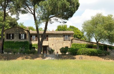 Photo for This grand, ancient stone house in the vineyards of the Tiber valley