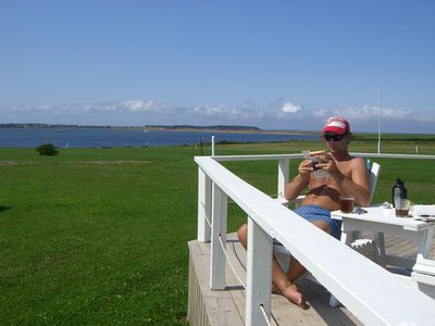 Suntanning, reading, enjoying a cold beverage ~does it get any better than this?