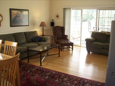 Living room with oriental rug and hardwood floors. Very comfortable furniture.