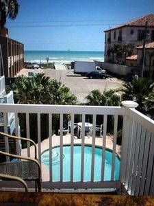 Photo for Surfside condo with balcony view,  125 steps to the beach, heated pool, sleeps 6
