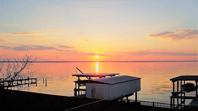 Photo for Water Front Lake House with Beautiful View of water and Sunsets!