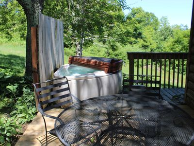 Photo for Couple's Retreat - Hot Tub, Fireplace & UBER to town!