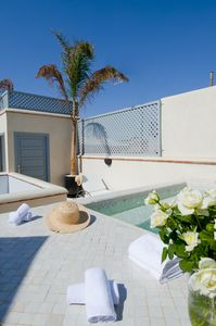 The terrace and pool/jacuzzi