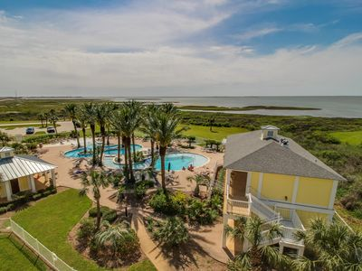 Photo for Stunning bayside condo close to the beach with shared pools!