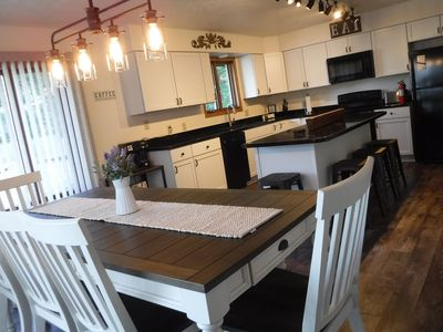 Farmhouse dining table & breakfast bar with plenty of seating