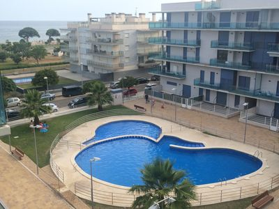 Photo for 2 APARTMENT WITH POOL IN FRONT OF ESQUIROL DE CAMBRILS BEACH