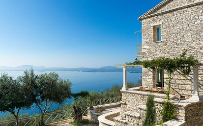 Photo for Luxury home with swimming pool and sea views, on a hill of olive trees.