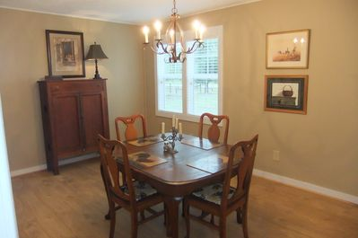 Dining room with quarter saw oak antique table and chairs