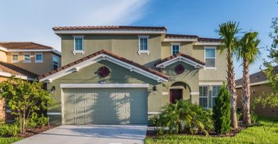 Photo for STUNNING and LUXURY South Facing Pool Home in a Gated Community!