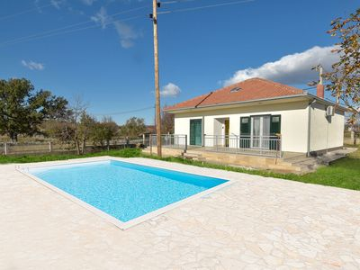 Photo for This 2-bedroom villa for up to 5 guests is located in Unešić/Unesic and has a private swimming pool,