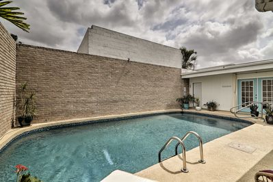 Enjoy private access out to the pool and patio!