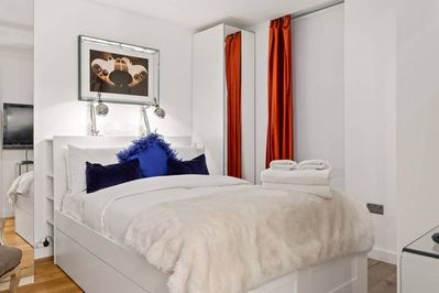 Bedroom with double bed and luxury bed linens.