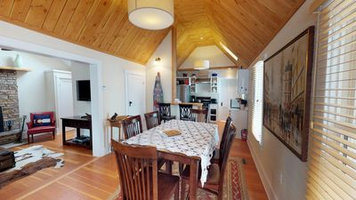 Dining room with high vaulted wood ceilings