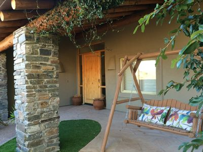 Front entry and porch with swing chair.  Perfect spot to read a book!