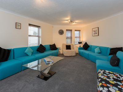 Photo for 5 Bed 4 bath WiFi sleeps 16,  Parking, Dining for 16,  Sea 5 mins