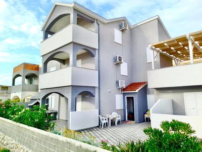 Photo for Three bedroom apartment with terrace and sea view Pag (A-18370-a)