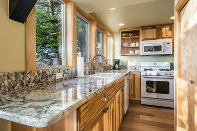 Kitchen with granite and hickory cabinets, with ocean view.
