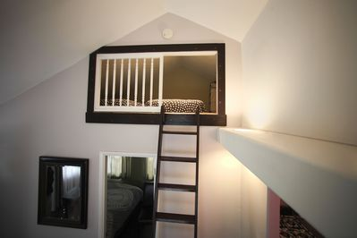 Ladder going up in the loft where two twin mattresses are available.
