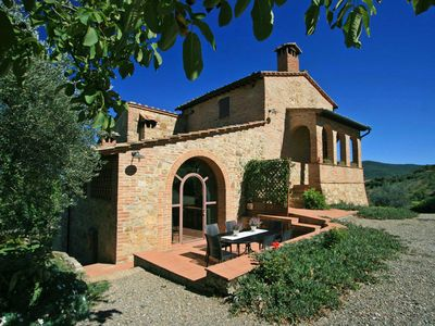 Photo for Tuscany villa with stunning views, private pool five minutes walk to the village