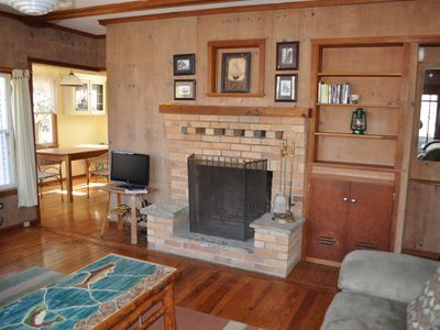Photo for Cozy cottage nestled in wooded area with Crystal Lake private access