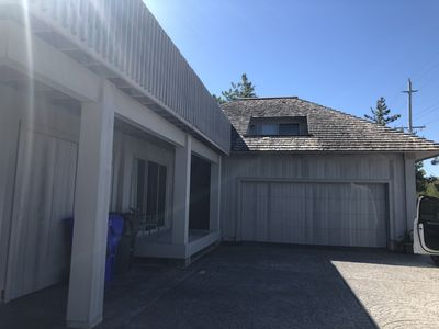 Rear of home with garage and driveway