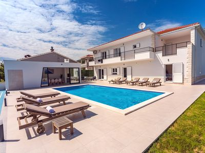 Photo for VILLA ALMIC with heated pool, 5 bedrooms, Media room,multi-use playground court