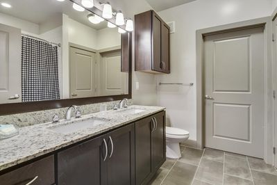 Large bathroom with dual vanity