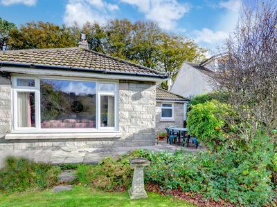 Photo for A neat detached bungalow in Llandre, 2 miles from Borth and Ynyslas (long sandy beaches) and 6 miles