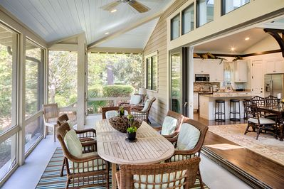 The large glass doors recede into the walls to enlarge the entertaining space.
