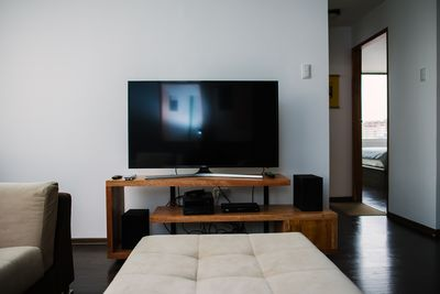 full entertainment center with Samsung TV and Denon stereo