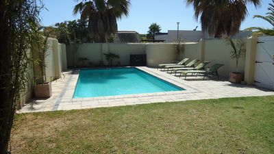 Private garden with large solar heated pool