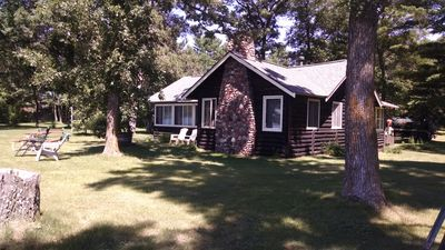 Photo for Charming Cabin with Beautiful Spooner Lake Front