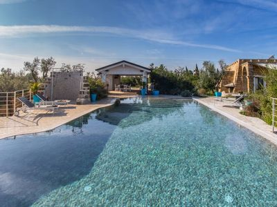 Photo for A luxurious apartment, adjacent to another, with a shared pool in the heart of Salento