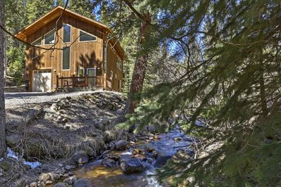 This 2-bed, 2-bath home is located on a stream!