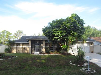 Photo for Serene setting,  heated pool,  canal view with fishing gear.
