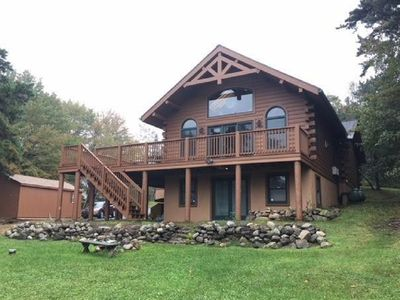 Photo for Rustic Lakefront Cabin feat. Spacious Great Room, Wraparound Deck, Gazebo & Dock