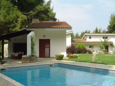 Photo for Exclusive villa with private swimming pool surrounded by woods
