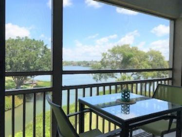 Photo for Chinaberry 941 - 2 Bedroom Condo with Private Beach with lounge chairs & umbrella provided, 2 Pools, Fitness Center and Tennis Courts.