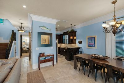 Entry and dining area, gourmet kitchen. Table seating for 8